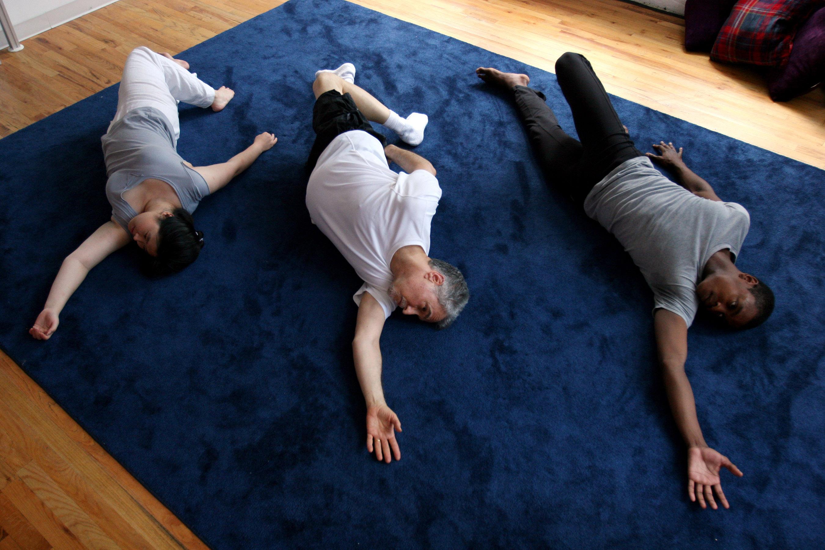 3 people lying on floor
