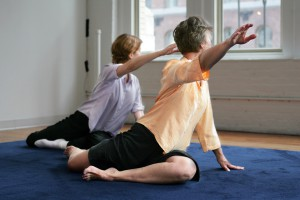 2 seated women explore Awareness Through Movement.