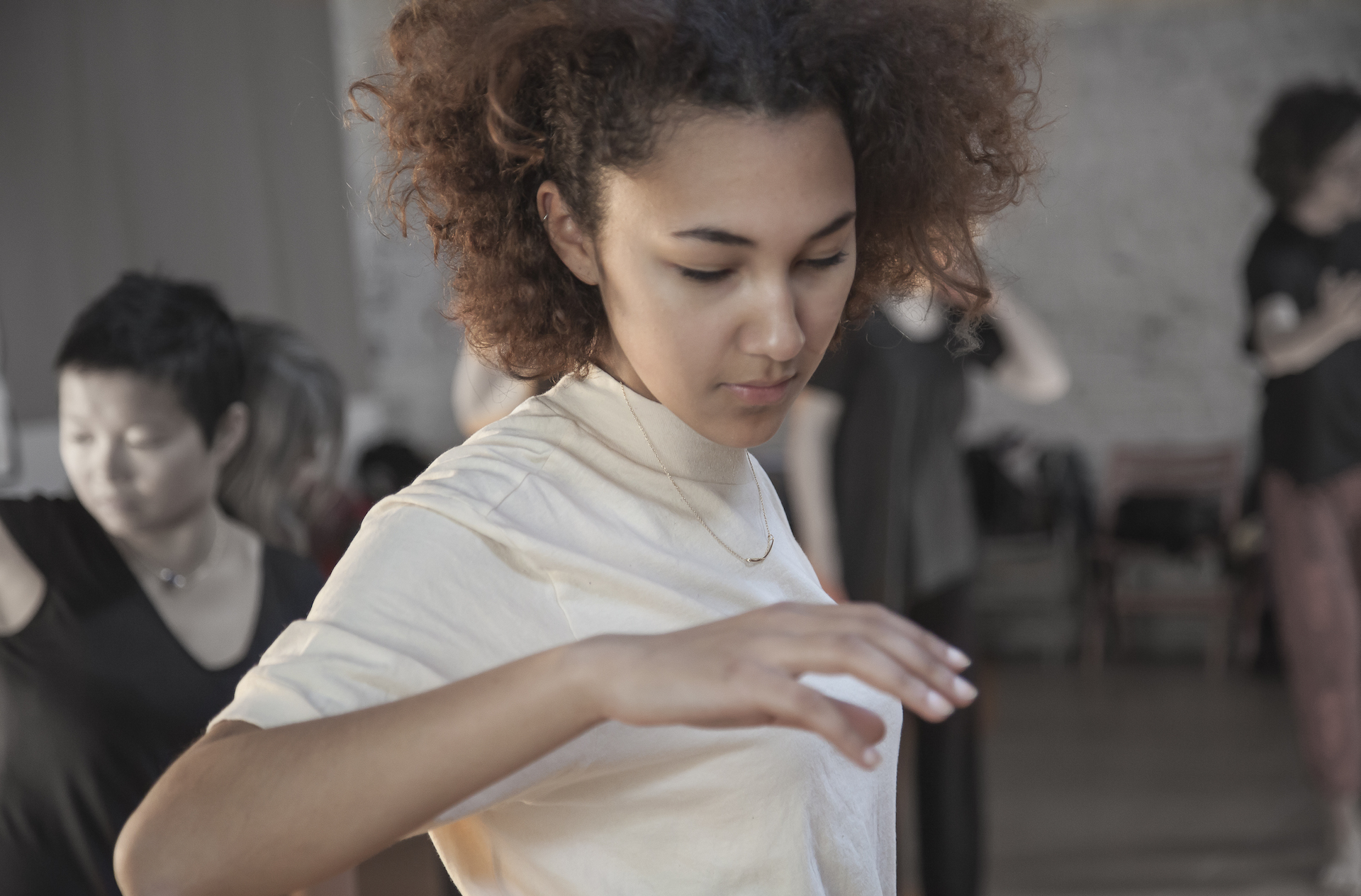 A young woman practices Awareness Through Movement.
