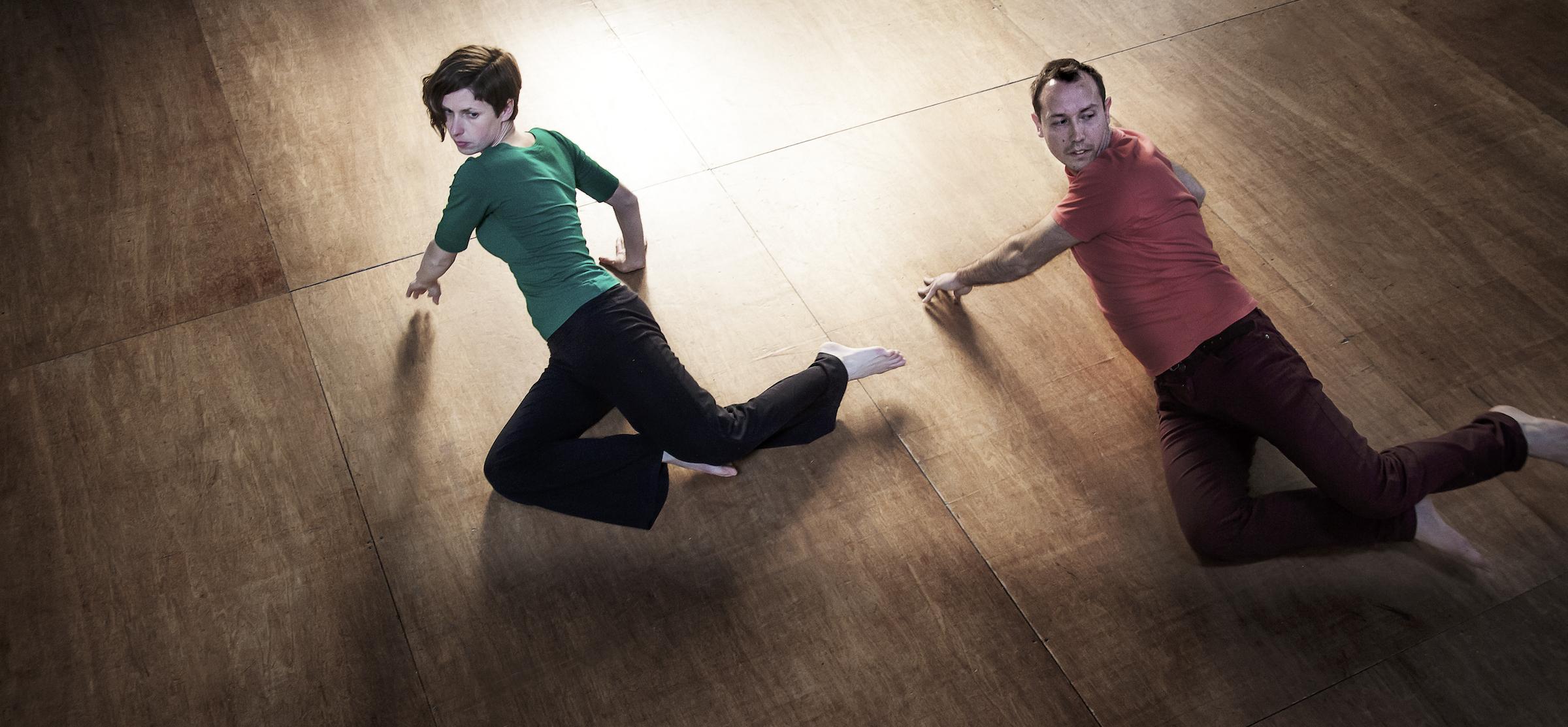 A woman and man practice Awareness Through Movement.
