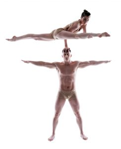 2 gymnasts posing in studio