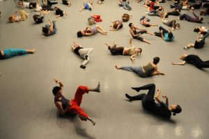 People explore Gaga movement lying on the floor.