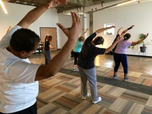 A group practices Tai Chi in Bobby Garcia's May workshop.