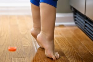 Child on tiptoes