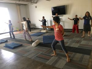 A group of students in an Awareness Through Movement class